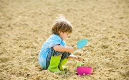 Happy child gardener. botanic worker. Spring season. health and ecology. earth day. new life. summer farm. ecology life. Eco farm. human and nature. small kid stock photography