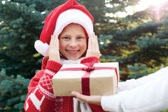 Happy child gets a Christmas surprise. Stock Photos