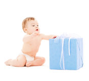 Happy child with gift box Royalty Free Stock Images