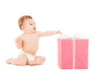 Happy child with gift box Royalty Free Stock Photos