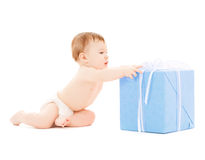 Happy child with gift box Stock Photos