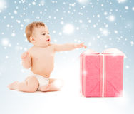 Happy child with gift box Stock Photos