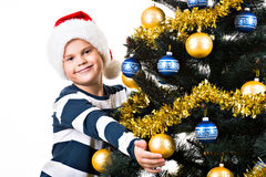 Happy child with gift near Christmas tree Royalty Free Stock Images