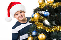 Happy child with gift near Christmas tree Royalty Free Stock Photography