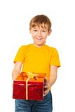 Happy child with gift from Santa Stock Image