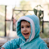 Happy child girl. A happy girl child in winter blue clothing stock photography