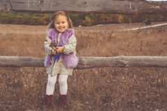 Happy child girl in autumn filed Stock Image