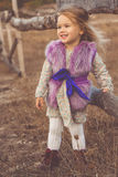 Happy child girl in autumn filed Royalty Free Stock Photo
