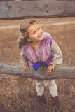 Happy child girl in autumn filed Royalty Free Stock Images