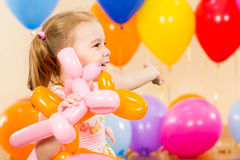 Happy child girl with balloons on birthday party royalty free stock photos