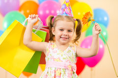 Happy child girl with balloons, gifts on birthday Royalty Free Stock Photos
