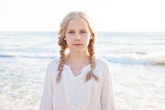 Happy Child Girl on the Beach Stock Photo