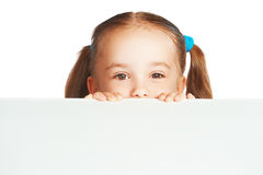 Happy child girl and blank white poster billboard Stock Photography