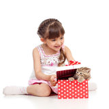 Happy child girl with cat in gift box. Happy child girl holding gift box with kitten Stock Photo