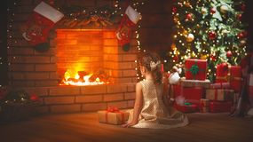 Happy   child girl with christmas gift at home Stock Photography