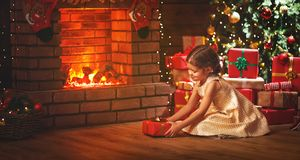 Happy   child girl with christmas gift at home Royalty Free Stock Photo