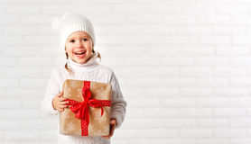 Happy child girl  with Christmas gifts Stock Photos