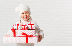 Happy child girl  with Christmas gifts Stock Image