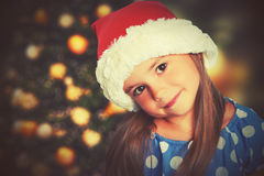 Happy child girl in a Christmas hat royalty free stock image