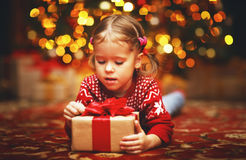 Happy child girl with Christmas present Royalty Free Stock Image