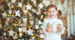 Happy child girl with Christmas present Stock Photos