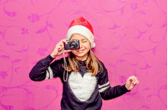 Happy child girl in a Christmas taking a picture with camera Stock Photography