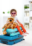 Happy child girl collect suitcase on vacation Stock Photography