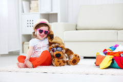 Happy child girl collect suitcase on vacation Stock Images