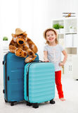 Happy child girl collect suitcase on vacation Stock Photo