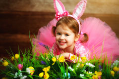 Happy child girl in  costume Easter bunny rabbit on grass and fl Stock Photo