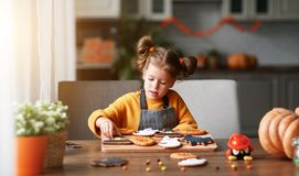 Happy child girl in costumes of pumpkins are preparing for  holi Royalty Free Stock Photography