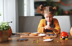 Happy child girl in costumes of pumpkins are preparing for holi royalty free stock photo