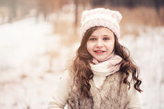 Happy child girl on cozy warm outdoor winter walk Stock Photos