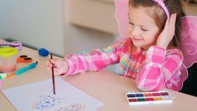 Happy child girl drawing inks art. Concept. creative hobby of little princess. lifestyle of talented people royalty free stock photography