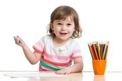 Happy child girl drawing with pencils Royalty Free Stock Images
