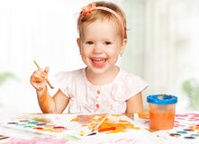 Happy child girl draws paints Royalty Free Stock Photo