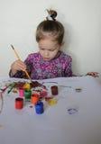 Happy Child Girl Draws Paints Stock Photography