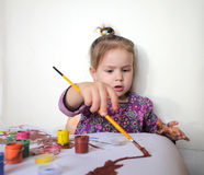 Happy Child Girl Draws Paints Stock Images