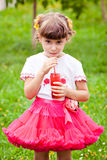 Happy child girl drinks juice Royalty Free Stock Image