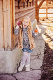 Happy child girl with easter chicken near country house Stock Images