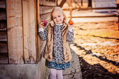 Happy child girl with easter chicken near country house Royalty Free Stock Images
