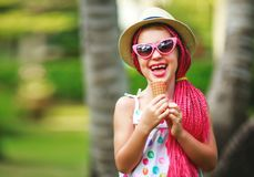 Happy child girl eat ice cream on summer stock images