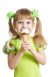 Happy child girl eating ice cream isolated Royalty Free Stock Photos