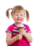 Happy child girl eating ice cream in studio isolated Royalty Free Stock Photography