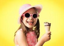 Happy Child Girl Eating Ice Cream in Summer stock image
