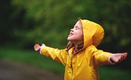 Happy child girl enjoying autumn rain Royalty Free Stock Photo