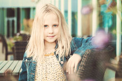 Happy Child Girl in European Street Cafe Stock Photo