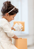 Happy child girl with gift box Stock Photos