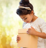 Happy child girl with gift box Stock Photography