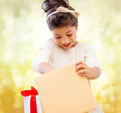 Happy child girl with gift box Stock Image